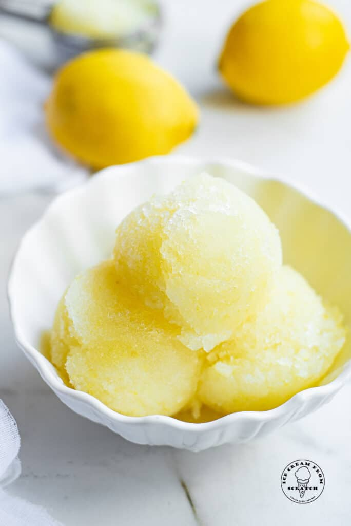three scoops of lemon sorbet in a white bowl