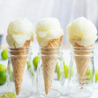 three ice cream cones with a scoop of lime sorbet
