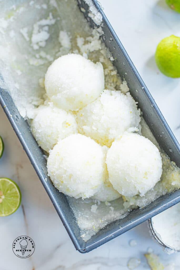 scoops of lime sorbet in a metal pan