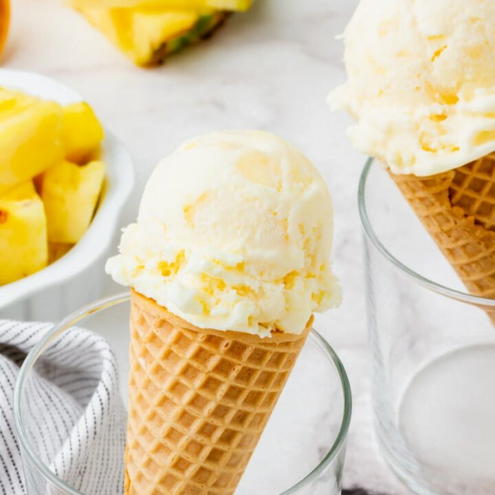 Pineapple ice cream in a cone