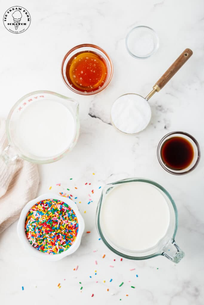 Ingredients for Sprinkles ice cream, all in separate bowls.