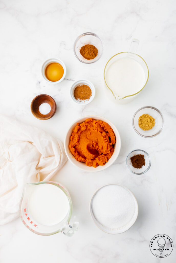 top down view of all of the ingredients needed to make pumpkin spice ice cream from scratch